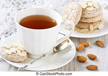 White cup tea and almond cookies - Porcelain white cup tea...