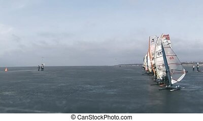 Start windsurfing race - Start winter windsurfing race time...