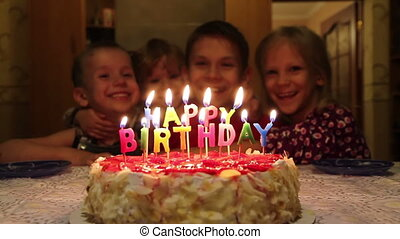 Birthday Cake - Burning candles in the form of an...