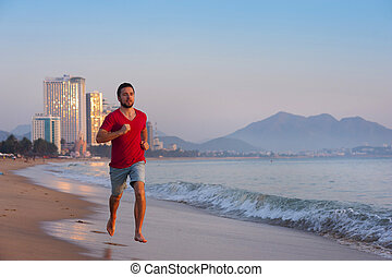 Sport man doing exercise at the city beach. - Sport active...