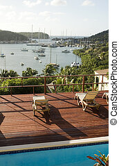 view English Harbor Antigua island Caribbean Sea from deck with swimming pool
