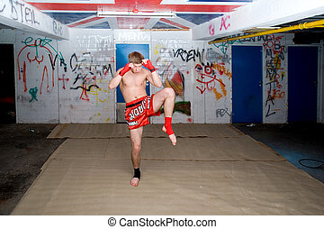 Warming Up - A Muay Thai figher warming up in a sburban...