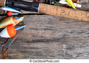 Fishing tackle on a wooden table as a background