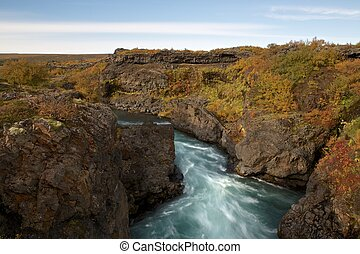 Time lapse photo of small canyon stream in Iceland