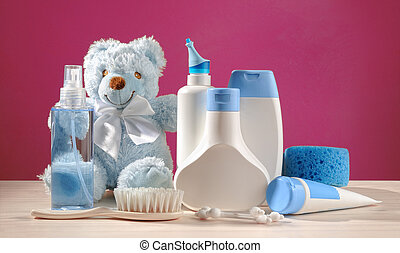 toiletries baby, blue items and pink background