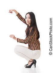woman squat and hold something - Attractive Asian woman...