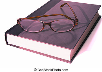 book with eyeglasess on top full view - full view of...
