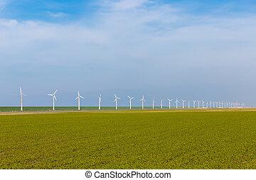 Wind turbines in wide Dutch farmland