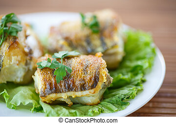 fried walleye - Walleye fish roasted on lettuce leaves on a...