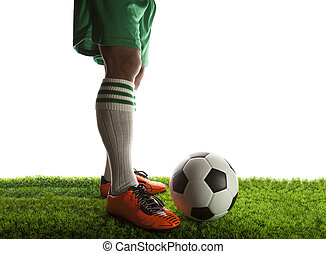 legs of football player ,soccer player and soccer ball...