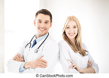 two young attractive doctors - bright picture of two young...
