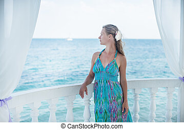 Young woman looking at the sea.