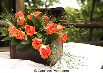 Rose flower arrangement - A flower arrangement with red...