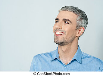 Mature casual man looking away - Senior happy man looking up...