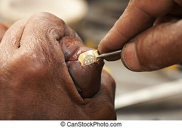 Jeweler making rings - Goldsmith working on an unfinished 22...