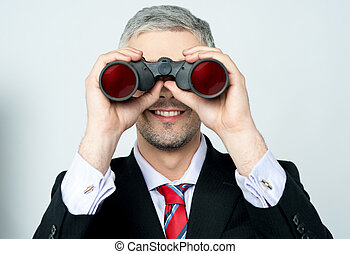 Businessman hunting talents - Businessman viewing through...