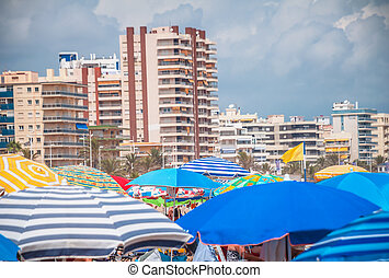 Umbrellas in the beach of Gandia, Spain