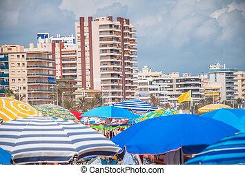 Umbrellas in the beach of Gandia, Spain