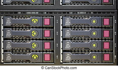 LED Hard Drive Array on Rack Server showing hard drives are...
