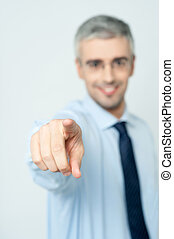Man pointing a finger towards you - Senior business man...