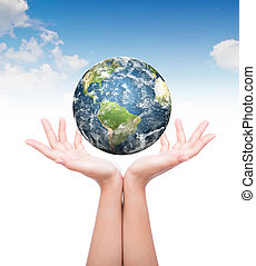 Hands with earth Elements of this image furnished by NASA