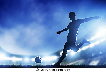 Football, soccer match. A player shooting on goal. Lights on...