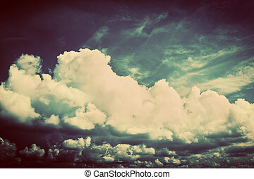 Sky with fluffy clouds. Retro, vintage style background