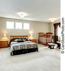 Master bedroom with a nursery area