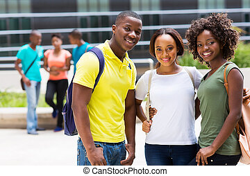 group of african american college friends outdoors - group...