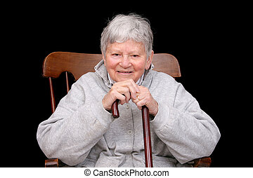 elderly lady sitting - one elderly adult female sitting in a...