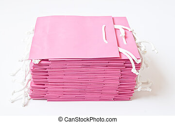 Stack of Pink shopping bags, isolated on white background