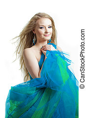 Stylish woman in a blue dress on a white background