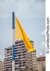 Yellow flag on beach - Yellow flag on the beach in Gandia,...