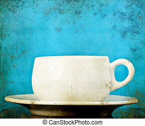 White coffee cup on vintage background
