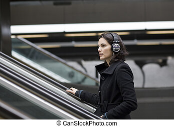 Music underground - Young woman listening music with big...
