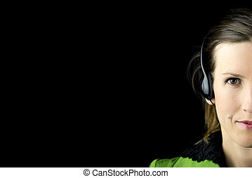 Attractive woman wearing a headset - Partial view of the...