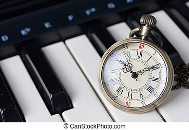 Pocket watch on keyboard