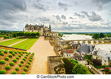 Amboise medieval castle or chateau and bridge on Loire river...