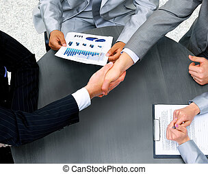 Businessmen shaking hands Top View