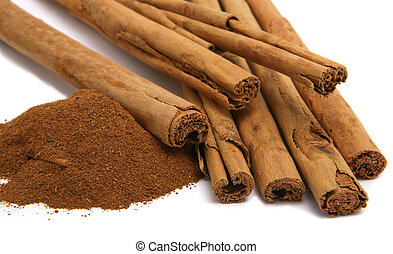 cinnamon powder and bark isolated on white