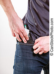 Closeup Careless man putting wallet in his pocket Theft -...