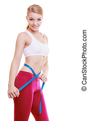 Fitness girl measuring her waistline isolated. Weight loss....