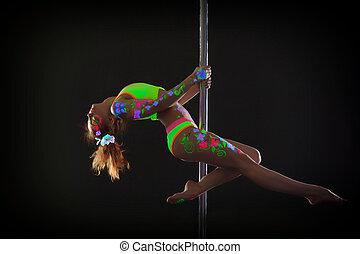 Graceful red-haired young woman dancing on pole - Image of...