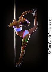Sexy young pole dancer doing vertical splits