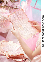 Old letters in woman's hands. - Woman in a vintage dress...
