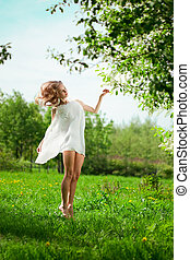 Spring woman blossoming garden - Beautiful spring woman in...