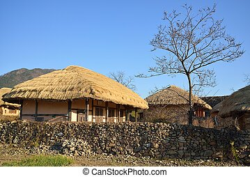 thatched roof house in Korean Traditional old town called...
