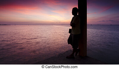 Silhouette of a man at sunset - Silhouette of a man watching...