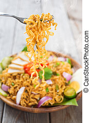 Spicy fried curry instant noodles or Malaysian style maggi...