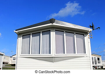 Caravan in trailer park with cloudscape - Exterior of modern...